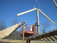 The crane lowers the rafters as the Great Northern Barns crew checks the placement for this frame in Westchester County, NY.